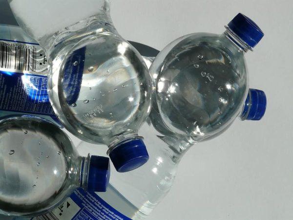 bottles plastic bottle bottle mineral water water transparent lid blue close